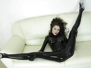 Hot whore wearing dark skinned LATEX dances