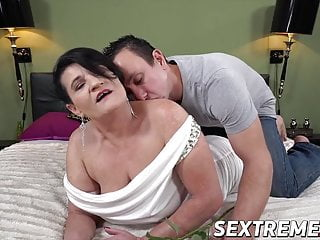 Depraved hot girl bangs younger man after giving him a cock sucking