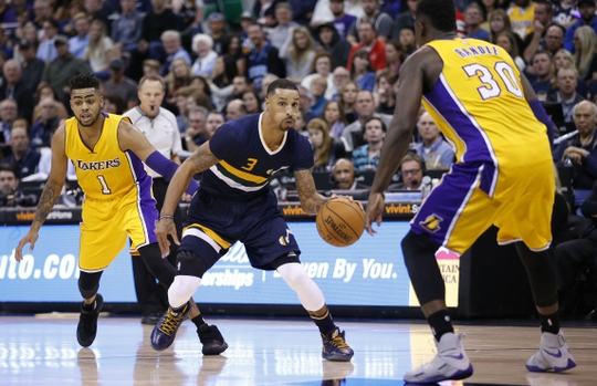 Oct 28, 2016; Salt Lake City, UT, USA;  Utah Jazz guard George Hill (3) looks to go to the hoop against Los Angeles Lakers forward Julius Randle (30) in the fourth quarter at Vivint Smart Home Arena. The Utah Jazz defeated the Los Angeles Lakers 96-89. Mandatory Credit: Jeff Swinger-USA TODAY Sports
