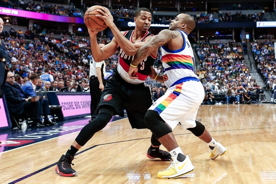 Oct 29, 2016; Denver, CO, USA; Denver Nuggets guard Jameer Nelson (1) guards Portland Trail Blazers guard C.J. McCollum (3) in the fourth quarter at the Pepsi Center. The Trail Blazers won 115-113 in overtime. Mandatory Credit: Isaiah J. Downing-USA TODAY Sports