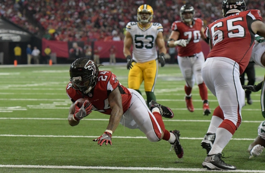 Oct 30, 2016; Atlanta, GA, USA; Atlanta Falcons running back Devonta Freeman (24) scores a touchdown against the Green Bay Packers during the second quarter at the Georgia Dome. Mandatory Credit: Dale Zanine-USA TODAY Sports