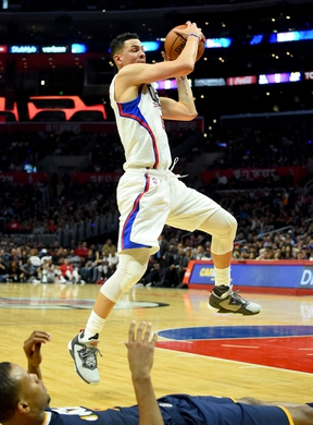 Oct 30, 2016; Los Angeles, CA, USA;  Los Angeles Clippers guard Austin Rivers (25) grabs a rebound in the second half of the game against the Utah Jazz at Staples Center. Clippers won 88-75. Mandatory Credit: Jayne Kamin-Oncea-USA TODAY Sports