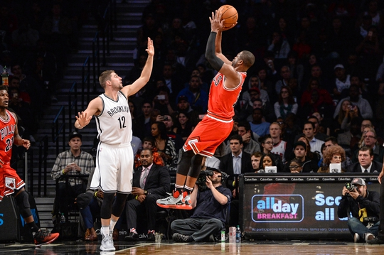 Oct 31, 2016; Brooklyn, NY, USA; Chicago Bulls guard Dwyane Wade (3) shoots the ball as Brooklyn Nets guard Joe Harris (12) defends during the third quarter  at Barclays Center. Mandatory Credit: Dennis Schneidler-USA TODAY Sports