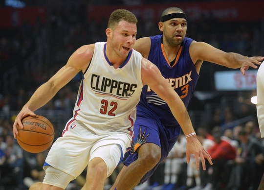 October 31, 2016; Los Angeles, CA, USA;  Los Angeles Clippers forward Blake Griffin (32) moves the ball ahead of Phoenix Suns forward Jared Dudley (3) during the first half at Staples Center. Mandatory Credit: Gary A. Vasquez-USA TODAY Sports