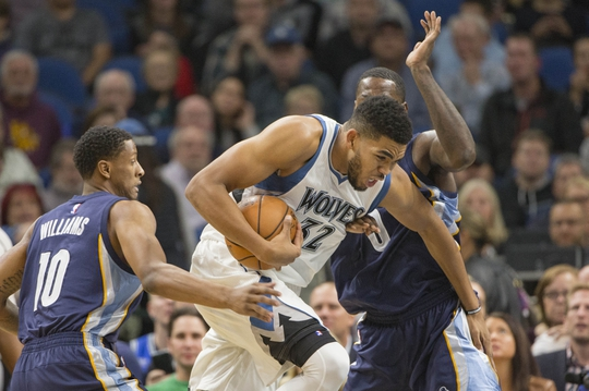 Nov 1, 2016; Minneapolis, MN, USA; Minnesota Timberwolves forward Karl-Anthony Towns (32) drives to the basket against Memphis Grizzlies forward Troy Williams (10) and forward JaMychal Green (0) in the first half at Target Center. Mandatory Credit: Jesse Johnson-USA TODAY Sports
