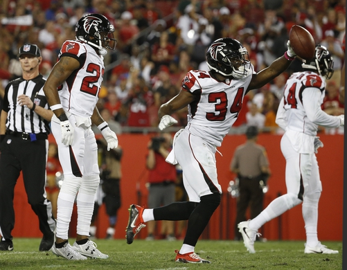 Nov 3, 2016; Tampa, FL, USA;  Atlanta Falcons defensive back Brian Poole (34) picks up the fumble against the Tampa Bay Buccaneers during the first half at Raymond James Stadium. Mandatory Credit: Kim Klement-USA TODAY Sports