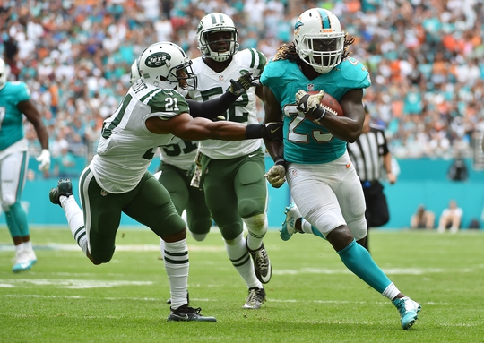 Nov 6, 2016; Miami Gardens, FL, USA; Miami Dolphins running back Jay Ajayi (23) runs the ball for a touchdown against the New York Jets during the first half at Hard Rock Stadium. Mandatory Credit: Jasen Vinlove-USA TODAY Sports