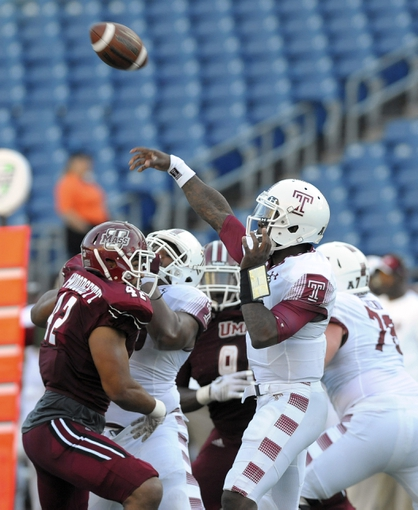 a251b3f19 (Source) TU s all white away uniforms worn in a 25-23 nail biting victory  over UMass. (Source) Temple s ...