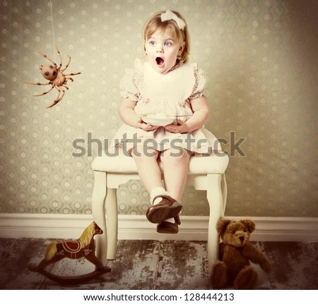 Little Miss Muffet shocked by spider - stock photo