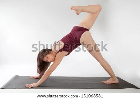 Woman in One Legged Downward Facing Dog Yoga Pose - stock photo