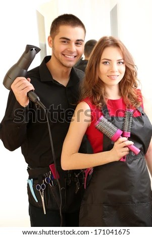 Young Man And Woman Hairdressers In Beauty Salon Stock Photo