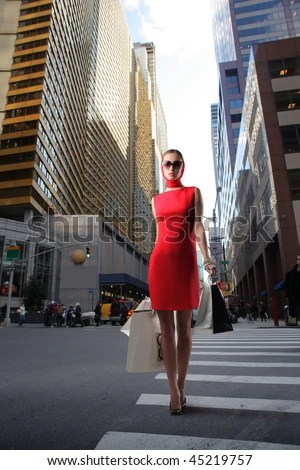 https://i2.wp.com/thumb7.shutterstock.com/display_pic_with_logo/160669/160669,1264332664,1/stock-photo-attractive-girl-in-red-dress-with-shopping-bags-crossing-a-city-street-45219757.jpg