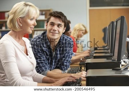 Students working on computers in library - stock photo