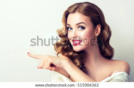 woman surprise holds cheeks by hand 库存照片 shutterstock