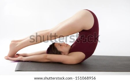 Woman in Plow Yoga Pose  - stock photo