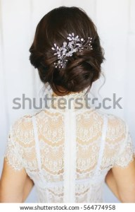 Tender Wedding Stylish Hairstyle Accessories Elegant Stock Photo     Tender wedding stylish hairstyle with accessories  Elegant brunette bride  standing back with collected up do