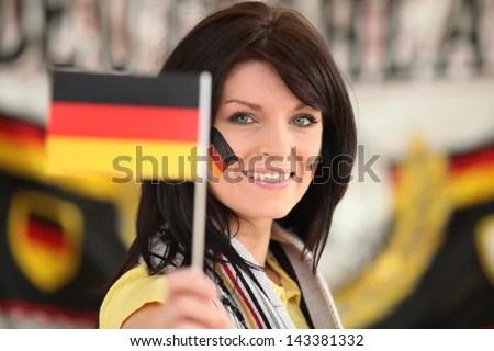 Woman supporting the German football team - stock photo