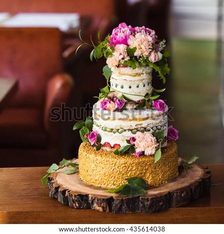 Fruit Wedding Cake Flowers On Cut Stock Photo  Royalty Free     fruit wedding cake with flowers on a cut tree
