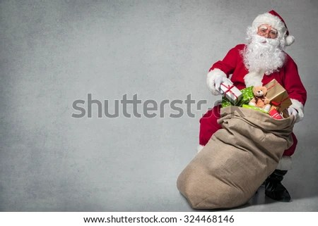 Santa Claus with a bag full of presents - stock photo