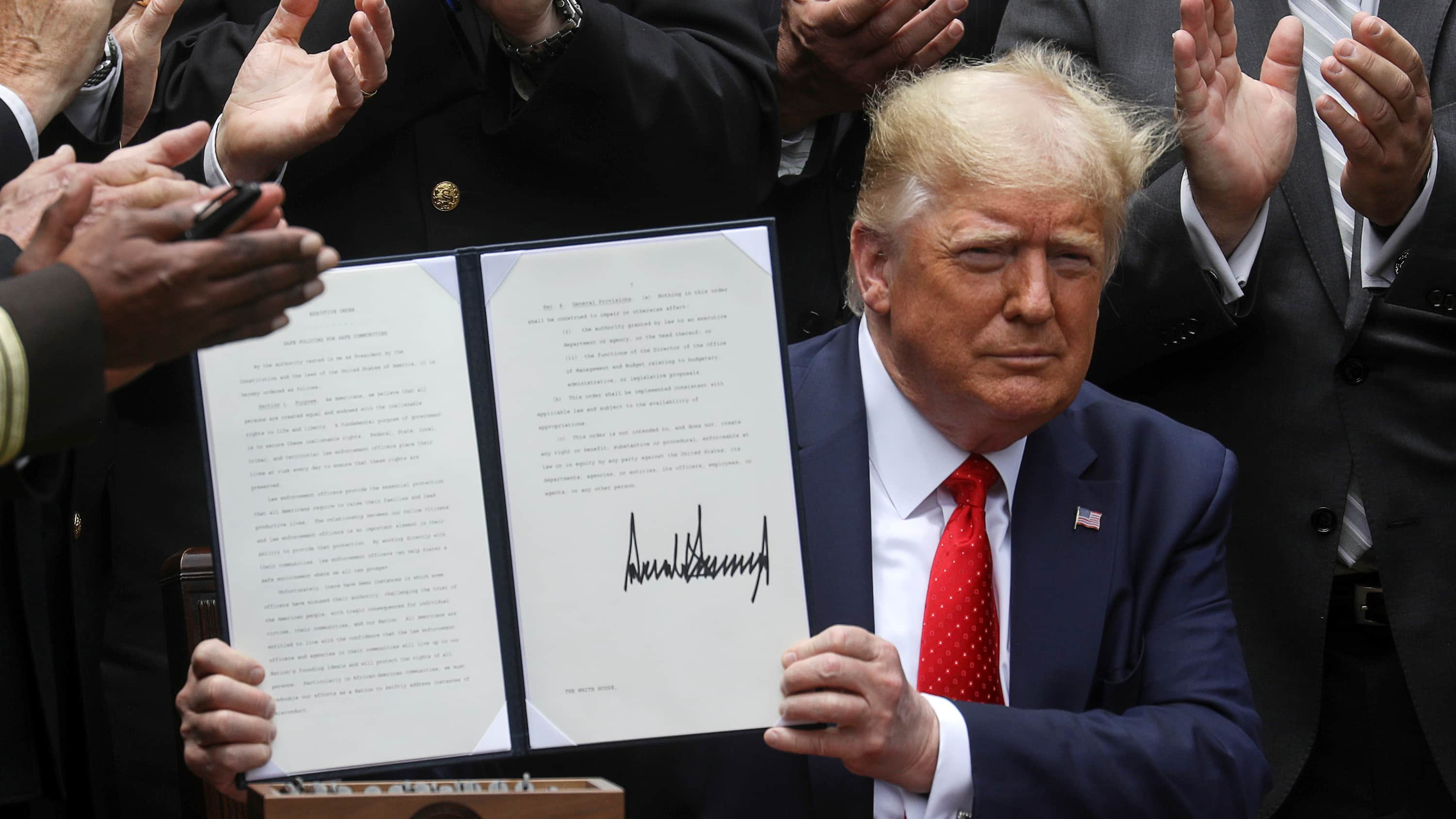 President Donald Trump signed an executive order aimed at tracking misconduct by law enforcers