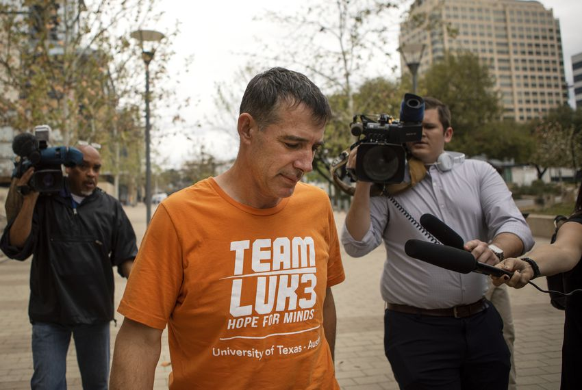 UT-Austin men's tennis coach Michael Center exited the federal courthouse Tuesday. The university placed Center on administrative leave after FBI documents revealed that he allegedly accepted a $100,000 bribe in 2015 to help a student's admission.