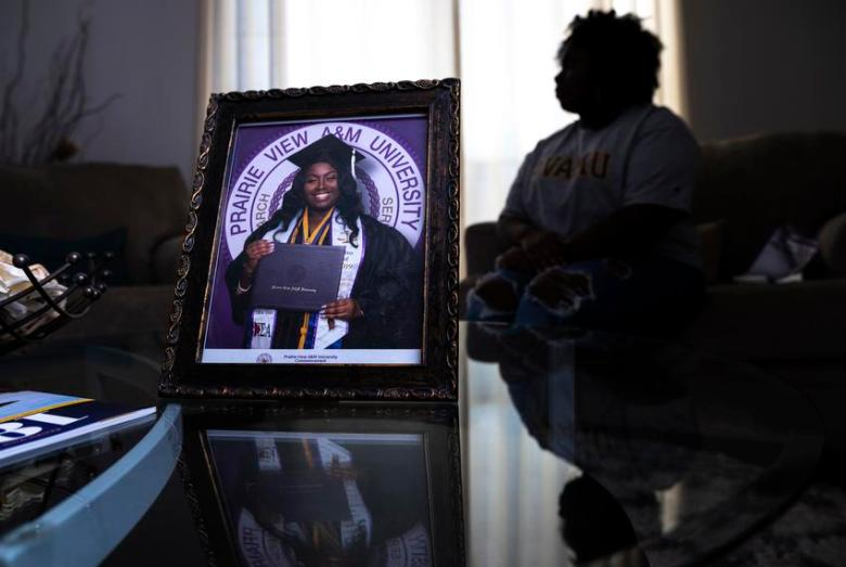 A portrait of Jayla Allen, 22, on her graduation day at Prairie View A&M University in 2019 at her family's home in Mesquite…