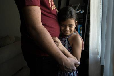 Heyli and her dad Carlos in their apartment in Los Angles.