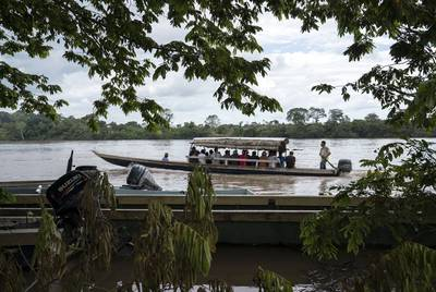 Migrants cross the Usumacinta River between La Técnica, Guatemala and Frontera Corozal, Mexico on Oct. 21. The Usumacinta River acts as a border between the two countries. There is no immigration inspection in either of the two borders in the area. This is a common route for Honduran migrants.