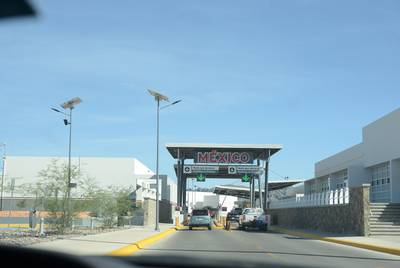 Cars wait to enter Mexico from Presidio, a small Texas town on the border.