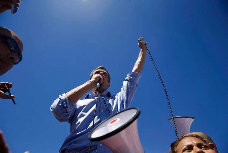 U.S. Rep. Beto O'Rourke, D-El Paso, speaks to the crowd marching on the tent city where children separated from their parents at the border are being held at Tornillo Land Point of Entry, on June 17, 2018.