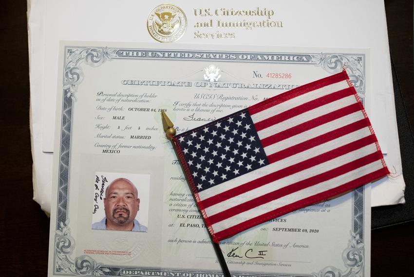 Navy Veteran Frank De La Cruz's flag and U.S. Naturalization Certificate he received after becoming a citizen last week. D...