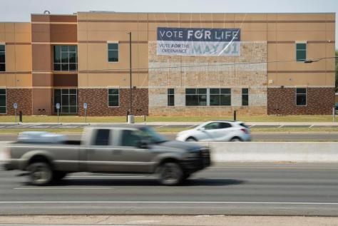 A banner supporting a proposed city ordinance that would ban abortions inside Lubbock city limits hangs from Trinity Church …