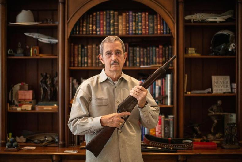 Former Land Commissioner  and State Sen. Jerry Patterson holds up a Winchester Model 1895 carbine, a model favored by the ...