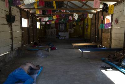 Honduran migrants Juan Ramón Andino, 60, left, and José, 40, right, sleep in a church that also serves as a migrant shelter in the community General Emiliano Zapata del Valle near Palenque, Chiapas on Oct. 24. The shelter is located along Highway 307 known as