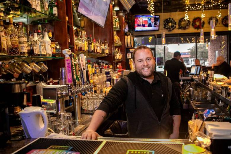 Lee Daugherty, owner of Alexandre's Bar in Dallas, pays his bartenders $8 an hour with a $15 per hour guarantee. The legal minimum wage for service workers who receive tips is $2.13 per hour.