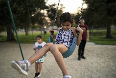 Heyli; her dad, Carlos; and her cousin Walter play in a park near their apartment in Los Angeles. Despite experiencing separation anxiety from the nearly two months she was kept from her father, Heyli is adjusting to her new life in the United States.