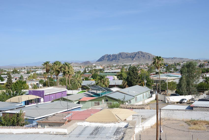 Seen from the balcony of El México de Ayer, a restaurant in Ojinaga, the city sprawls larger and more colorful than Presidio on the U.S. side of the border.