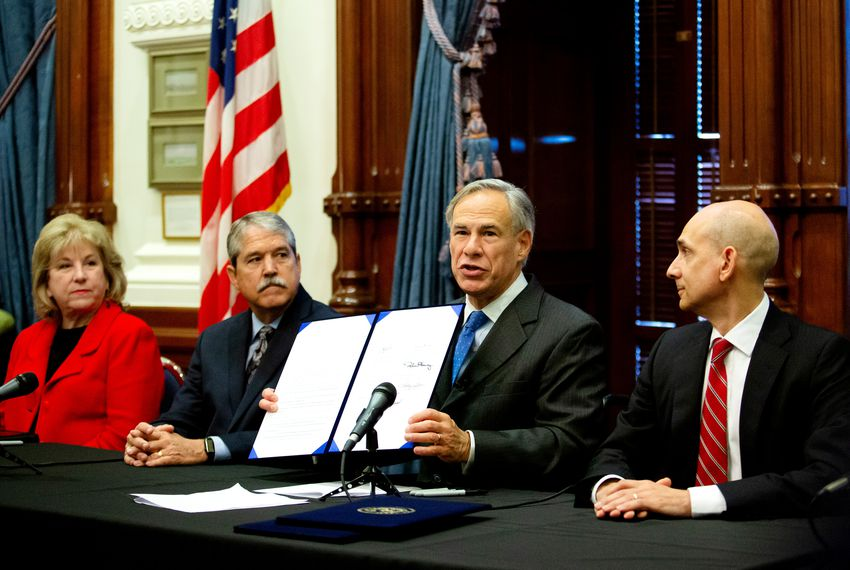 From left: State Sens. Jane Nelson, Larry Taylor and state Rep. Greg Bonnen look on as Gov. Greg Abbott talks about bills he's signed to improve school safety and provide greater mental health resources to students, in Austin on June 6, 2019.