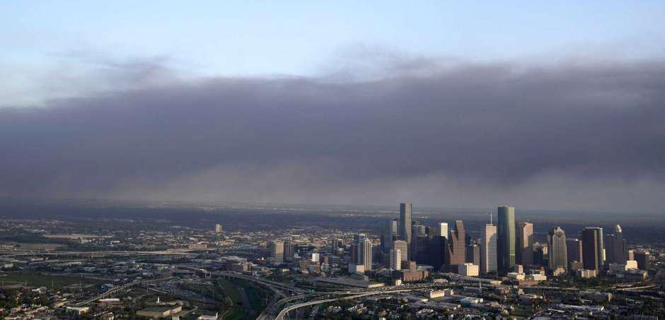 Smoke rising from a petrochemical fire at an Intercontinental Terminals Company facility drifts over Houston on Monday, March 18, 2019.