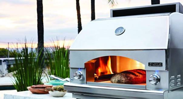 Outdoor kitchens are getting equipped with pizza ovens and other gourmet appliances.