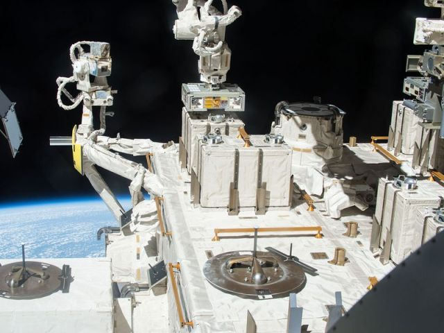 Robotic arm that is holding the bacteria that was tested in space
