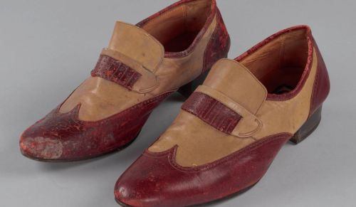 An elderly Fats Domino, after Hurricane Katrina, was airlifted to the Superdome from his flooded home in the Lower Ninth Ward. A pair of natty two-tone loafers salvaged from his waterlogged residence now resides in the Smithsonian collections.