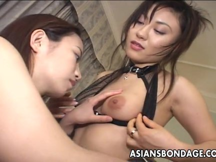 Roped up Asian slut eating out a wet muff_7