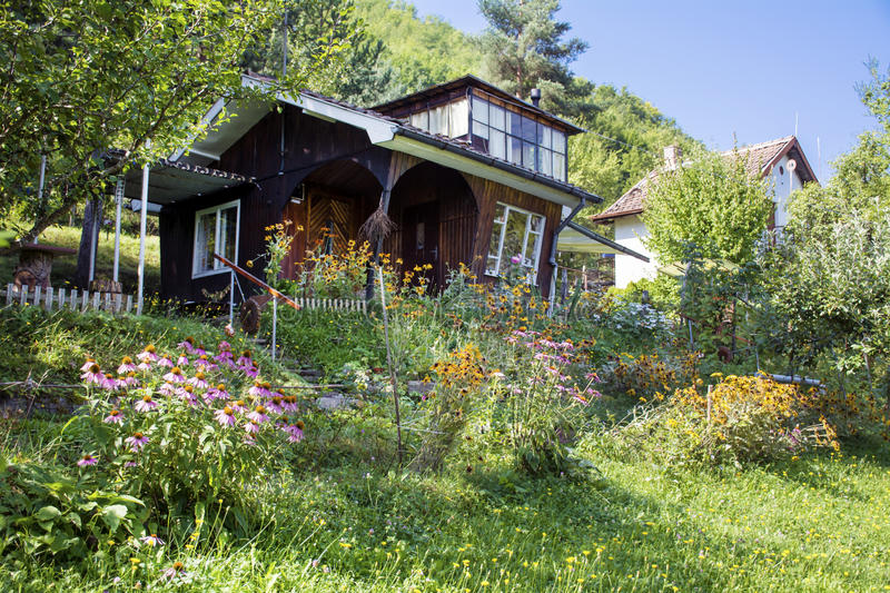 Beautiful Brown Wooden House With Big Green Garden Stock