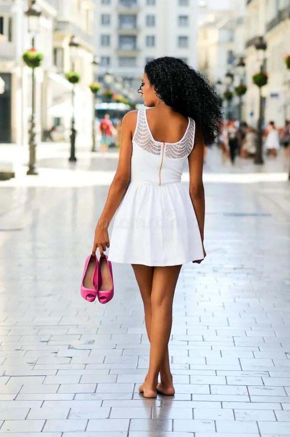Black Woman Afro Hairstyle Walking Barefoot Stock Image