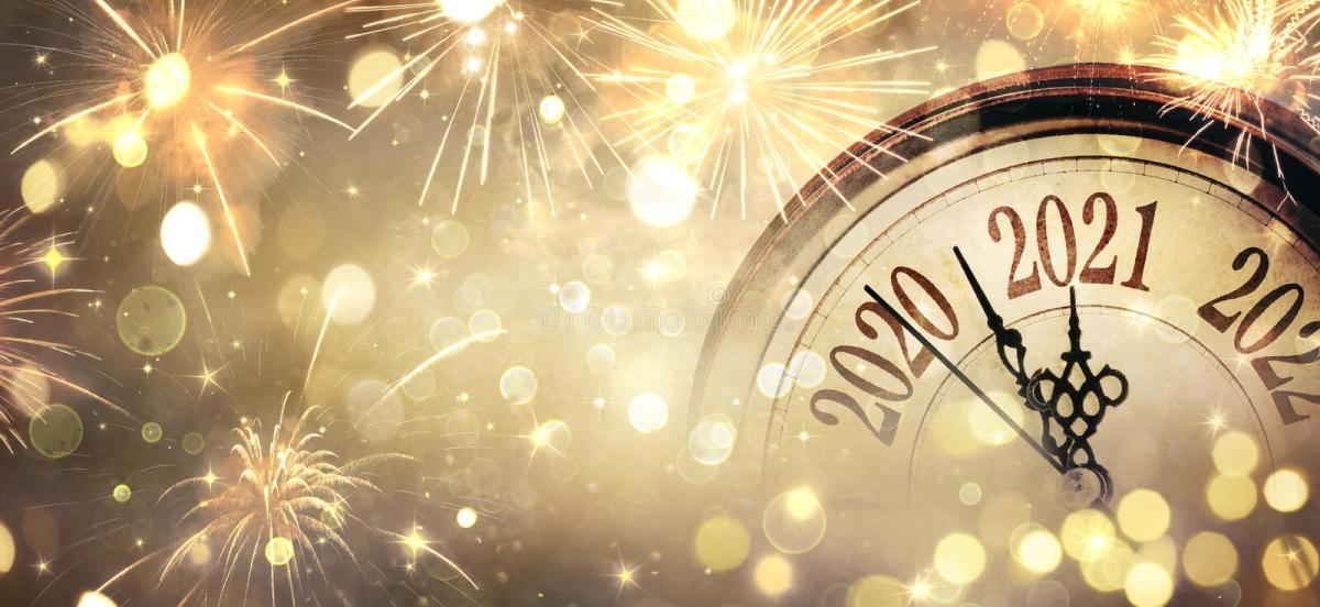 Countdown To Midnight - Happy New Year 2021 - Abstract Defocused Background. Clock And Fireworks royalty free stock images