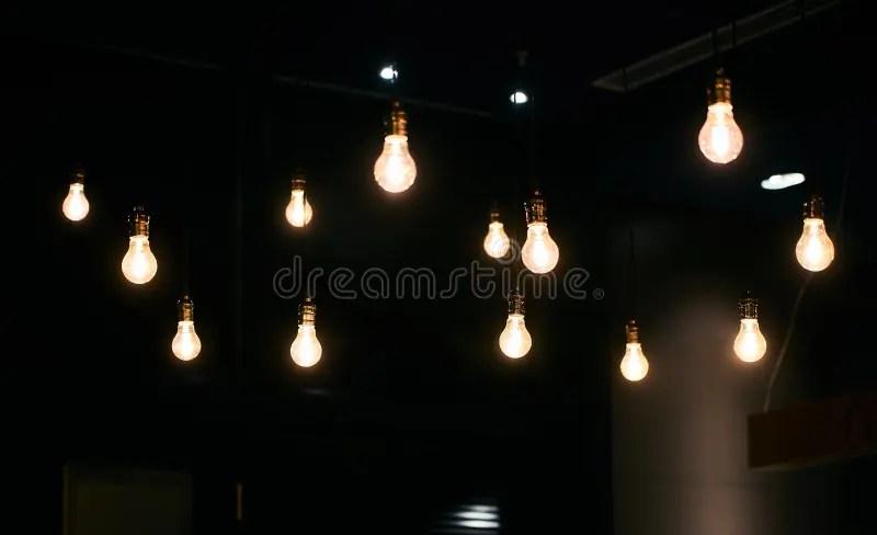 hanging light bulb background in dark