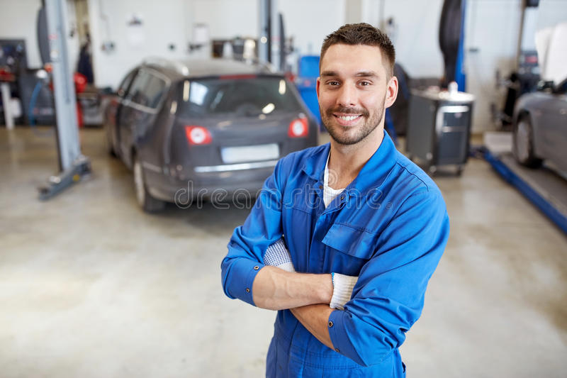 Happy Auto Mechanic Man Or Smith At Car Workshop Stock