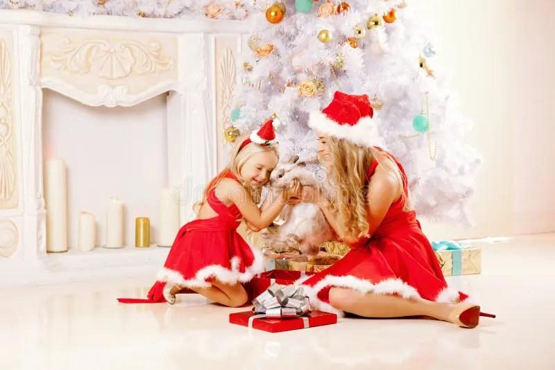 Mom And Daughter Dressed As Santa Celebrate Christmas