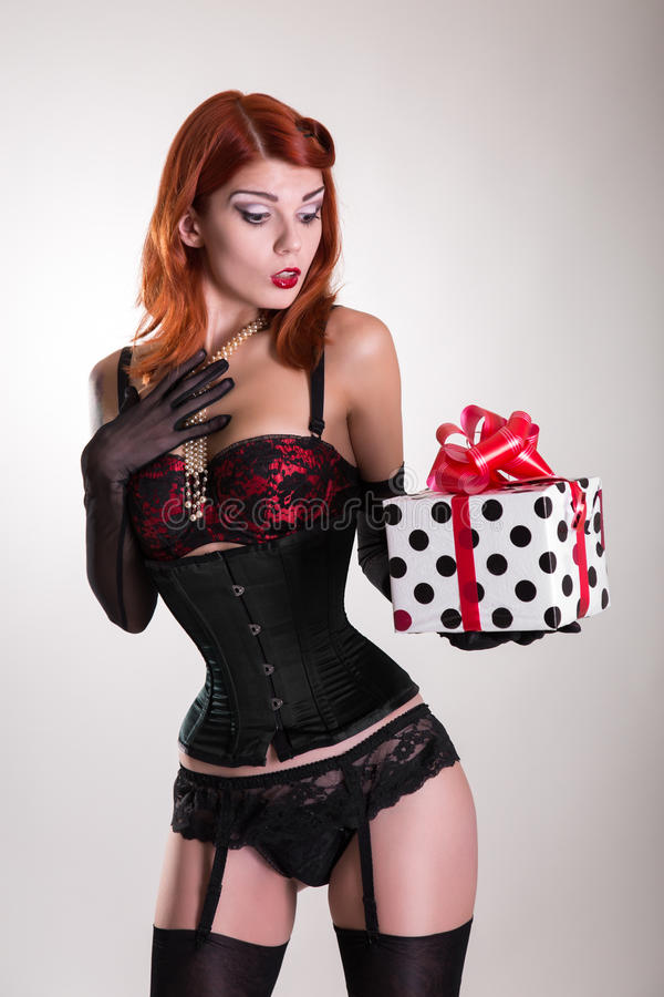 Portrait Of A Beautiful Redhead Pin Up Style Girl Holding